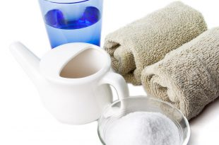 Neti pot with saltwater and towels